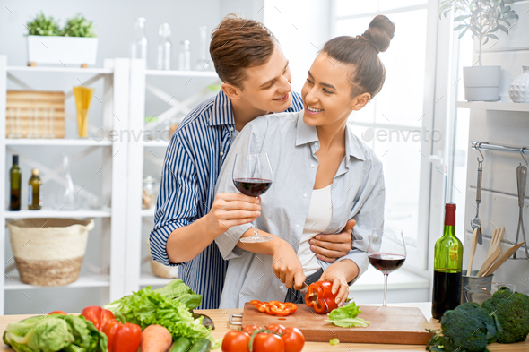 loving couple is preparing the proper meal - Stock Photo - Images