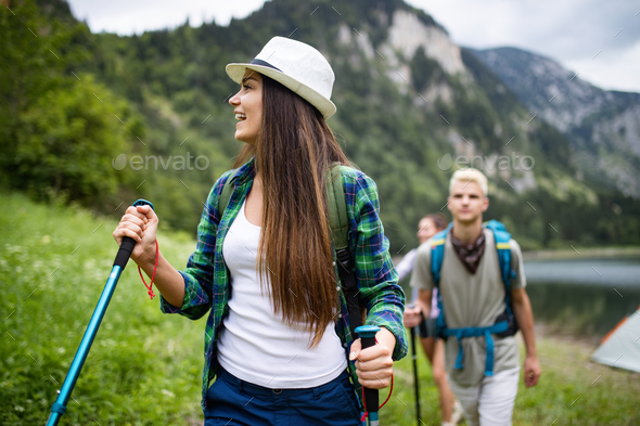Group of happy young people friends hiking together outdoor - Stock Photo - Images