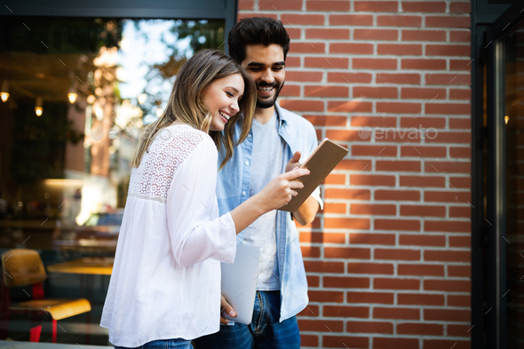 Travel, vacation, technology and friendship concept. Smiling couple with tablet in city - Stock Photo - Images