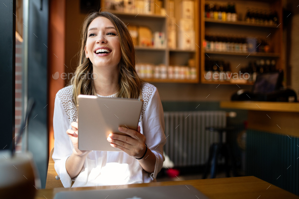 Happy girl working online or studying and learning while using tablet - Stock Photo - Images