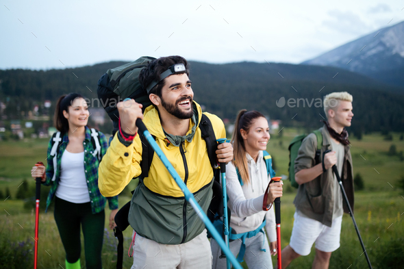 Adventure, travel, tourism, hike and people concept - group of smiling friends with backpacks - Stock Photo - Images