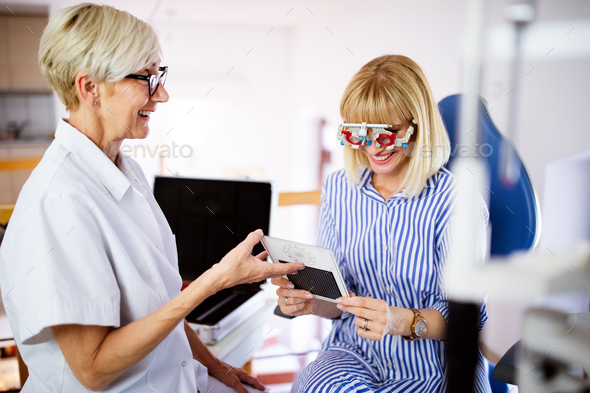 Ophthalmology concept. Patient eye vision examination in ophthalmological clinic - Stock Photo - Images