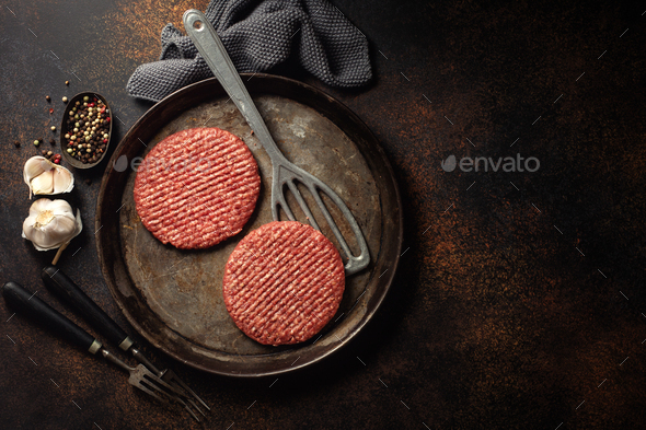 Raw burger meat on board - Stock Photo - Images