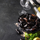 Bowl with fresh raw mussels with white wine, lemon and parsley on dark background, ready to cook - PhotoDune Item for Sale