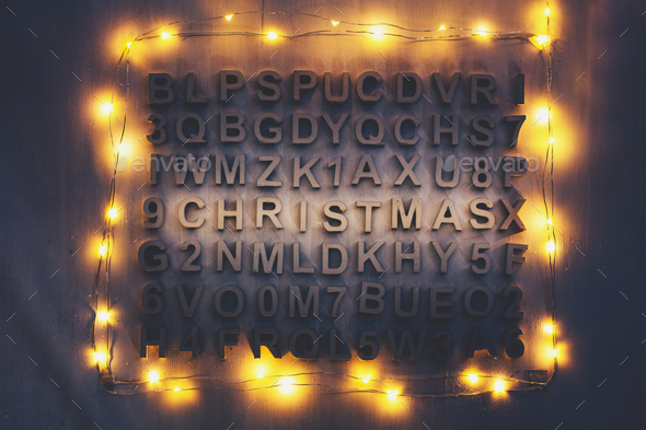 Christmas word made of wooden letters among other random letters. - Stock Photo - Images