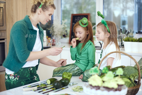 Mother with children cooking at kitchen - Stock Photo - Images