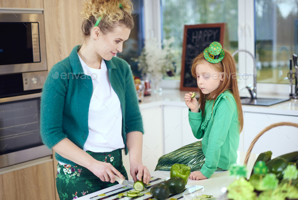 Woman teach child how to cut vegetable - Stock Photo - Images