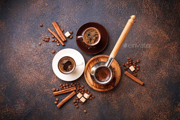 Cups of coffee, beans, sugar and cinnamon - Stock Photo - Images