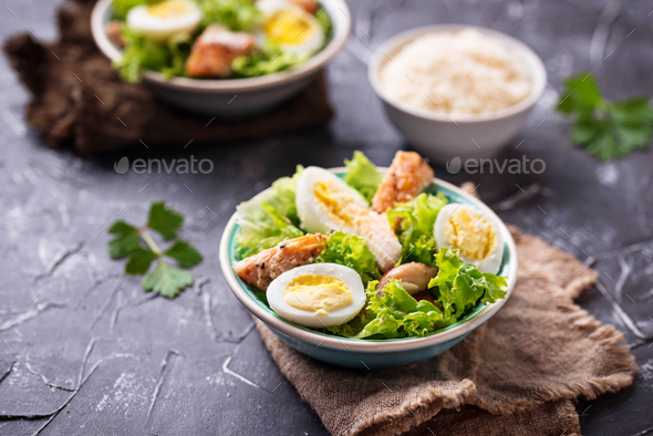 Caesar salad with eggs, chicken and parmesan - Stock Photo - Images