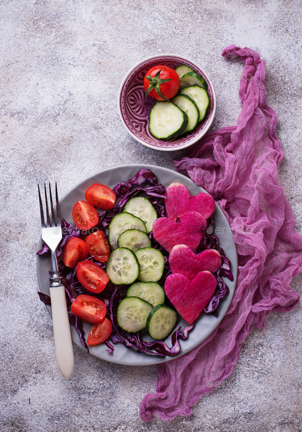 Salad with cucumber, tomato and red cabbage - Stock Photo - Images