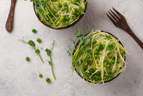 Zucchini pasta with green peas - Stock Photo - Images