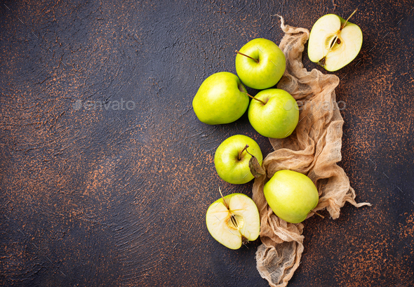 Fresh green apples on rusty background - Stock Photo - Images