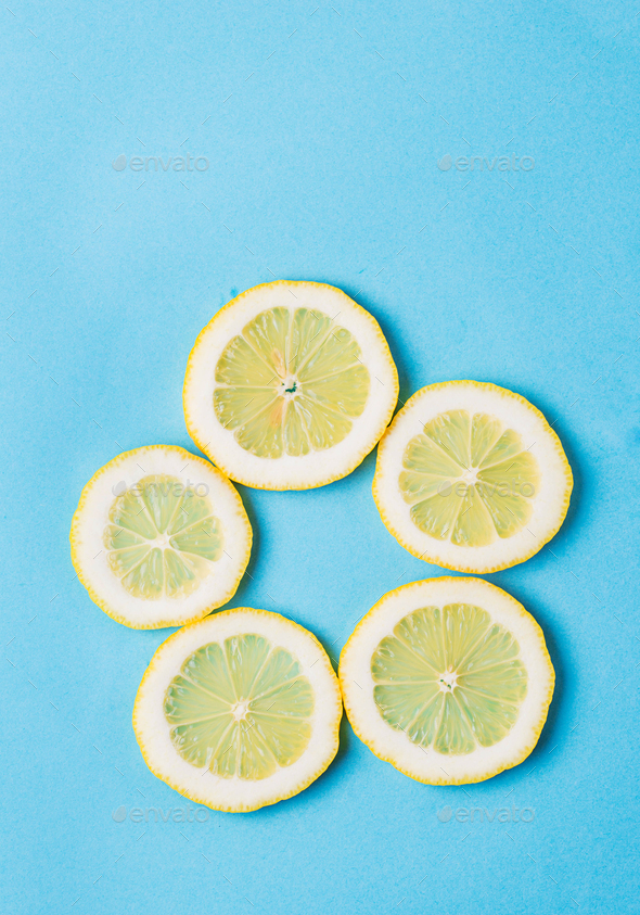 Sliced lemon on blue background - Stock Photo - Images