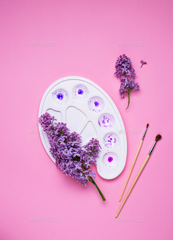 Lilac and artists palette with violet paint - Stock Photo - Images