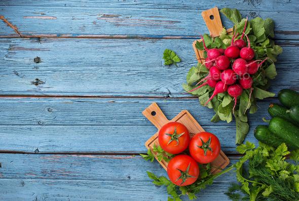 Tomato, radish and cucumbers on  blue background - Stock Photo - Images
