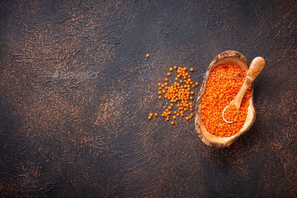 Bowl with red lentils on rusty background - Stock Photo - Images
