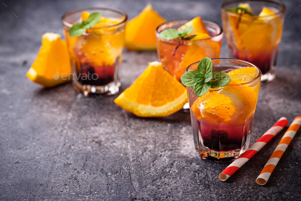 Summer  drink with orange and berries - Stock Photo - Images