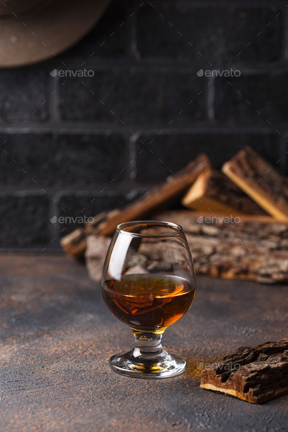 Glass of cognac or whiskey. - Stock Photo - Images