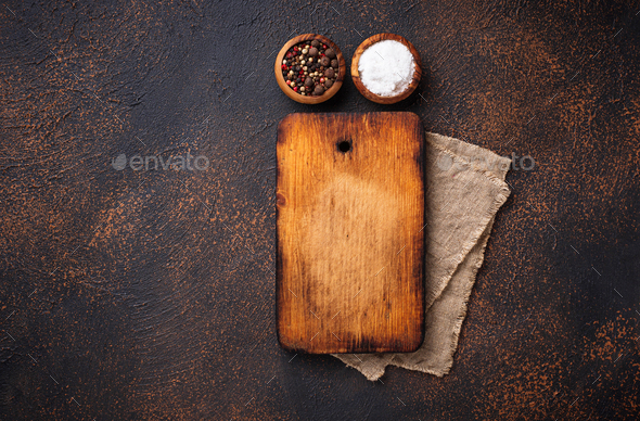 Empty vintage cutting board and spices - Stock Photo - Images