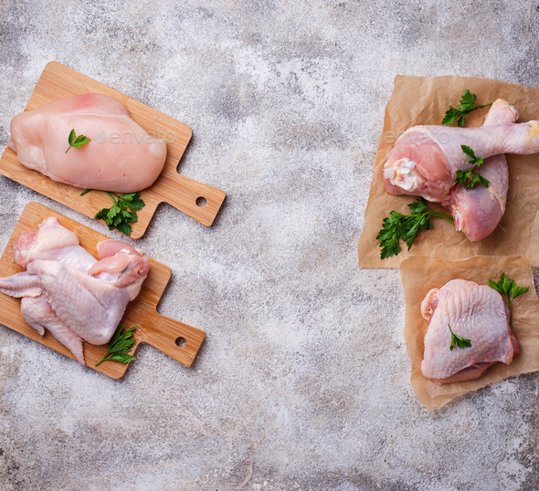 Raw chicken meat fillet, thigh, wings and legs - Stock Photo - Images