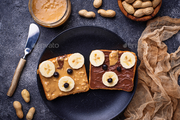Sandwiches with peanut butter in shape of bear - Stock Photo - Images