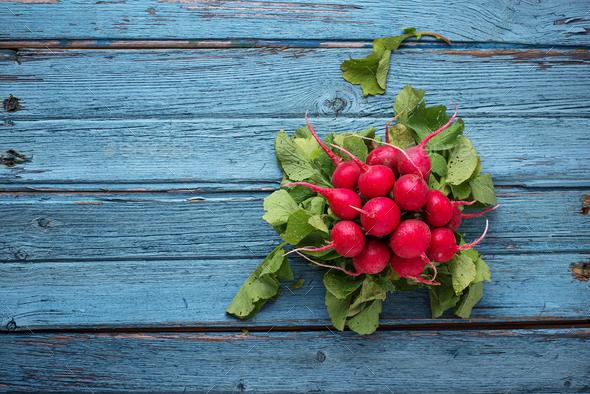 Fresh ripe radishes on blue table - Stock Photo - Images