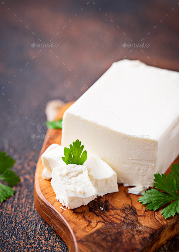 Feta cheese on rusty background - Stock Photo - Images