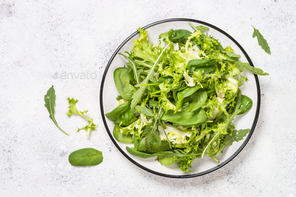 Green salad leaves mix on white top view - Stock Photo - Images