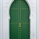 Green painted wooden door with gold colored decoration - PhotoDune Item for Sale