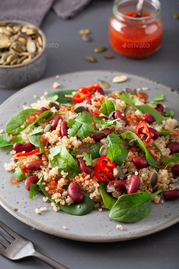 healthy bean and quinoa salad with spinach, chili - Stock Photo - Images