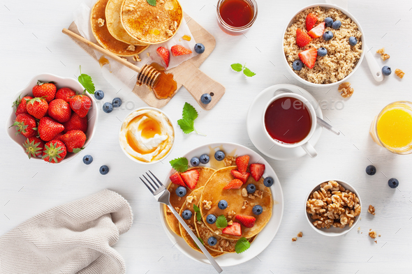 pancakes with blueberry strawberry honey and quinoa for breakfas - Stock Photo - Images