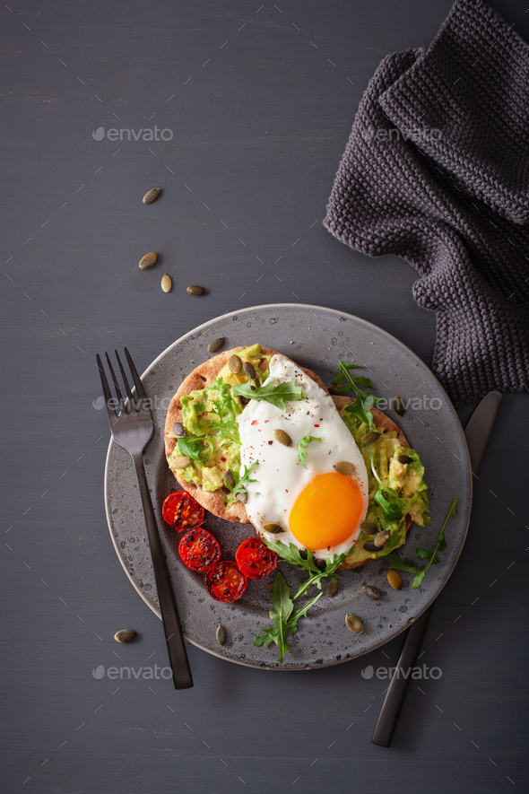 breakfast avocado sandwich with fried egg and tomato - Stock Photo - Images