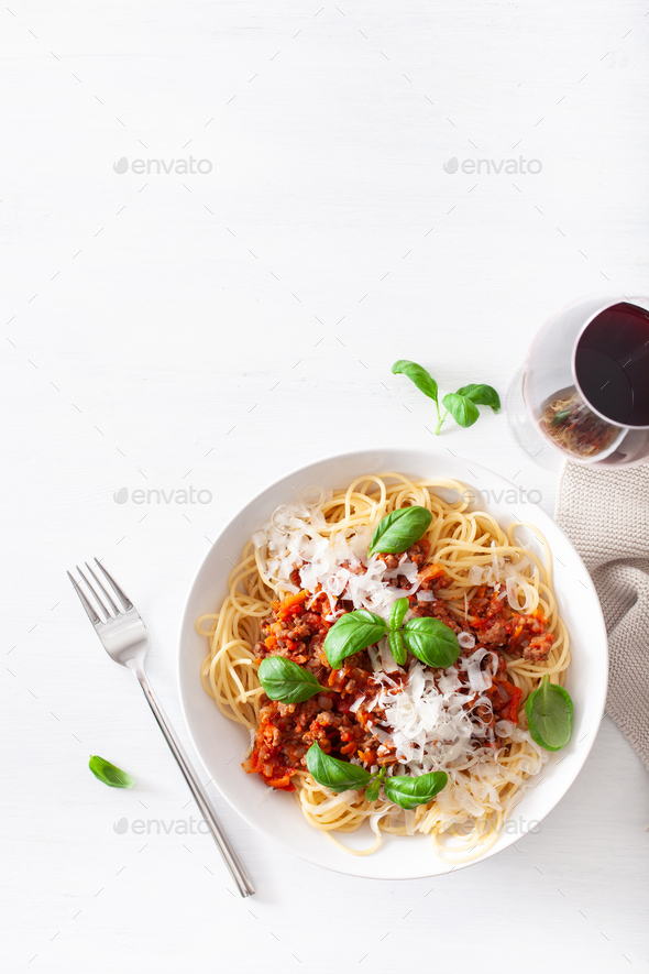 spaghetti bolognese with basil and parmesan, italian pasta - Stock Photo - Images