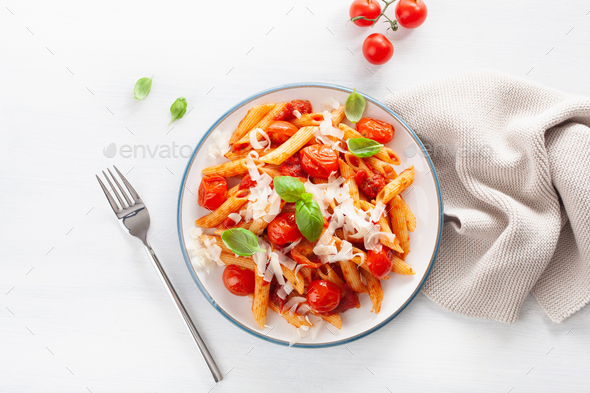 italian penne pasta with tomatoes parmesan basil - Stock Photo - Images
