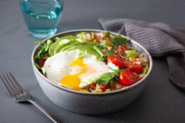 quinoa bowl with fried egg, avocado, tomato, rocket. Healthy veg - Stock Photo - Images
