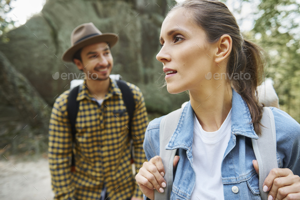 Tourists with backpacks hiking in the mountains - Stock Photo - Images