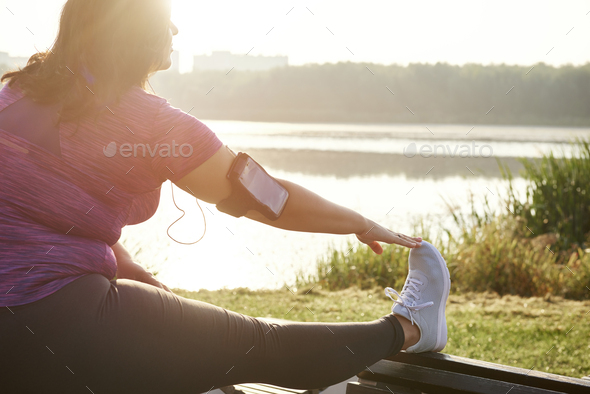Woman warming up before running - Stock Photo - Images