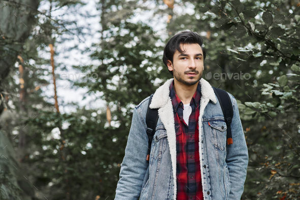 Portrait of adventurous hiker in forest - Stock Photo - Images