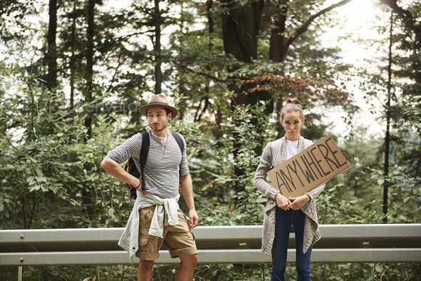 Portrait of young couple backpacking - Stock Photo - Images
