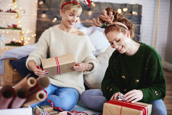 Young women preparing christmas gifts - Stock Photo - Images