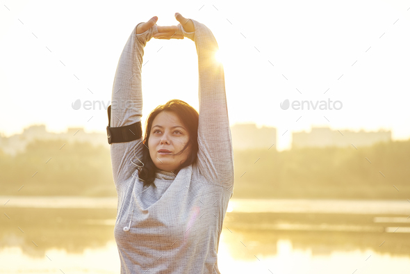 Morning exercising surrounded by nature - Stock Photo - Images