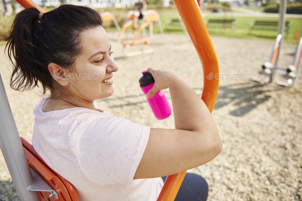 Young, happy woman exercising outdoors - Stock Photo - Images