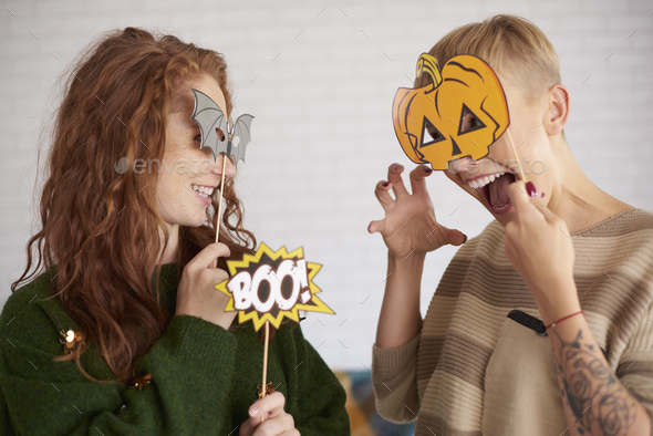 Friends with funny halloween masks - Stock Photo - Images