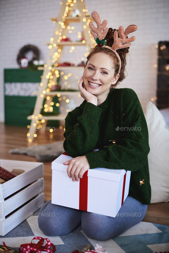 Portrait of smiling woman with reindeer antlers - Stock Photo - Images