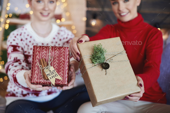 Woman's hands giving christmas presents - Stock Photo - Images