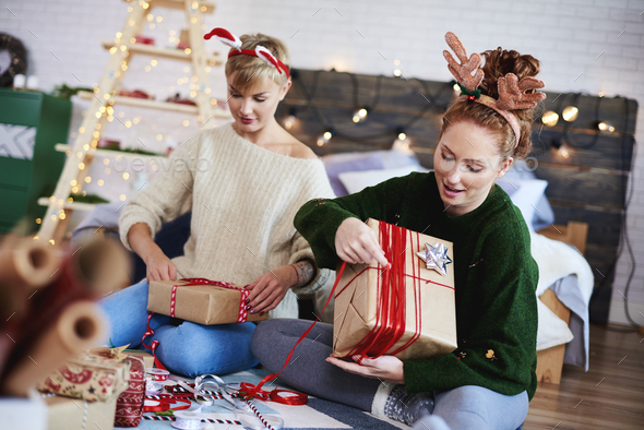 Friends preparing christmas gifts for Christmas - Stock Photo - Images