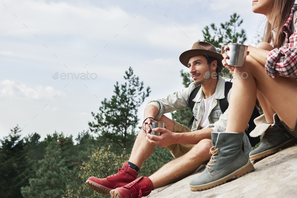 Backpackers drinking coffee and looking at view in the mountains - Stock Photo - Images