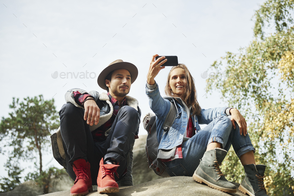 Happy couple making a selfie during hiking trip - Stock Photo - Images