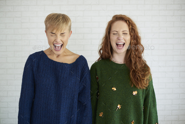 Front view of two excited girls shouting - Stock Photo - Images