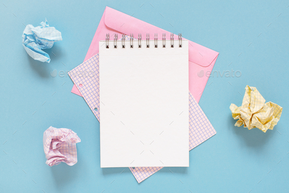 Blue Workplace with Open Notepad and Crumpled  Sheets of Paper - Stock Photo - Images